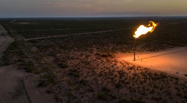 © Bloomberg. A gas flare in a field near Mentone, Texas. Photographer: Bronte Wittpenn/Bloomberg