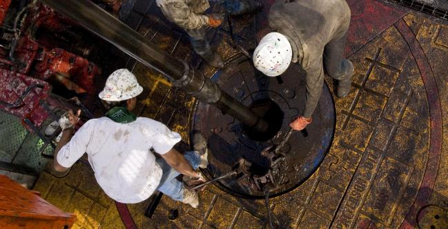 © Bloomberg. A natural gas well being drilled in the Eagle Ford shale in Karnes County, Texas.